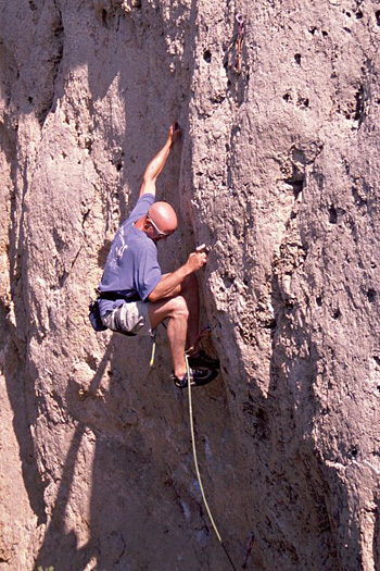 Keith McCallister focusing on the feet in sending the technical Pistols & Gri Gris, at Wild Iris, WY.