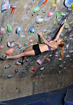 Indoor walls provide unlimited opportunity to practice the twist lock and backstep move. Note here the twist off the left arm and the backstepping right foot.