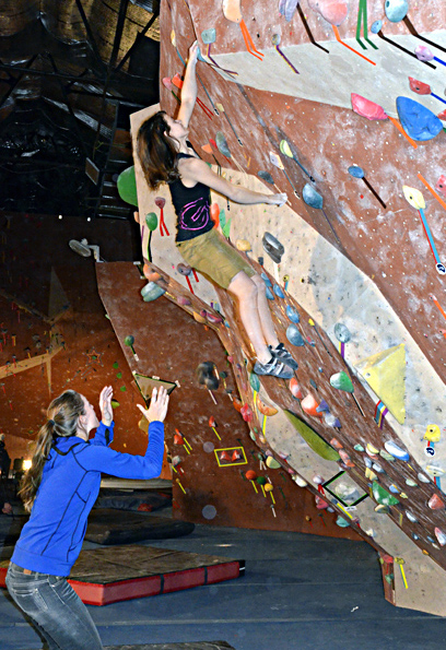 Zoe Steinberg spotted by attentive coach, Alex Johnson. Quality coaching and a vigilant spot (or belay) is critical minimizing injury risk.